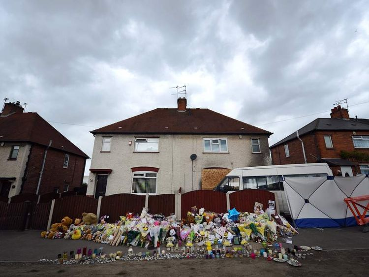 Floral tributes adorn the pavement outside a house in Allenton after a fire claimed the lives of six children.
