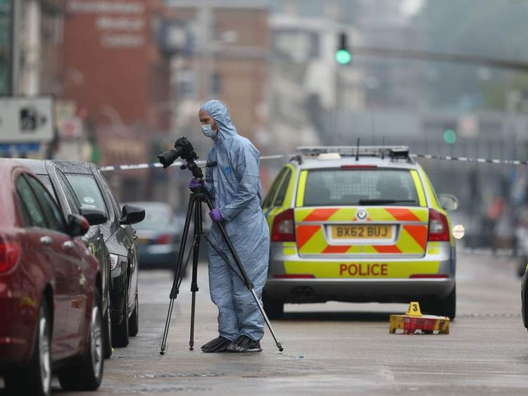 A forensic officer at the scene of a shooting in Kilburn, London