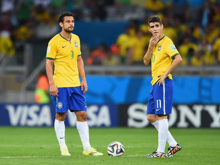 Brazil v Germany: Semi Final - Dejected looking Fred and Oscar of Brazil