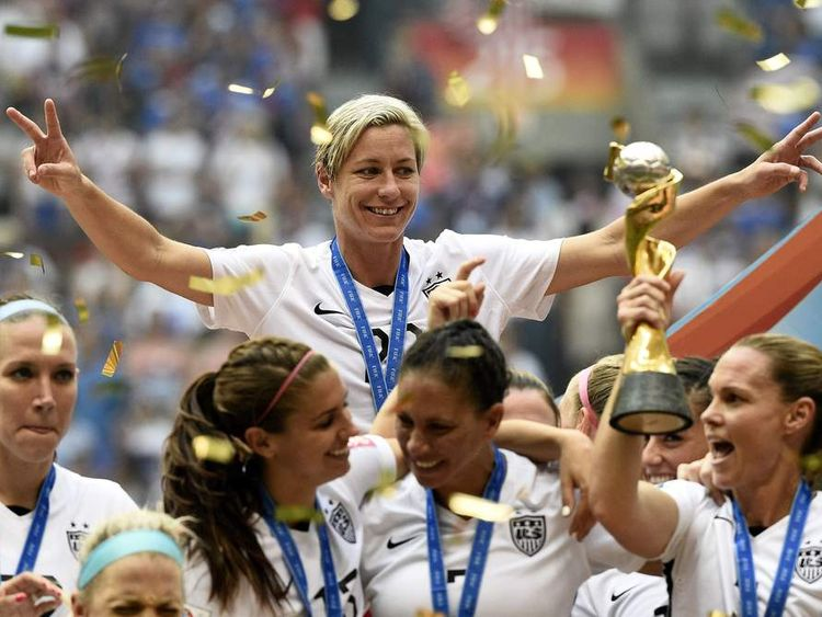 US star Abby Wambach celebrates with her teammates