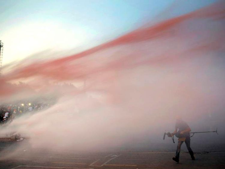 Protesters attacked by police water cannon in Gezi park near Taksim square