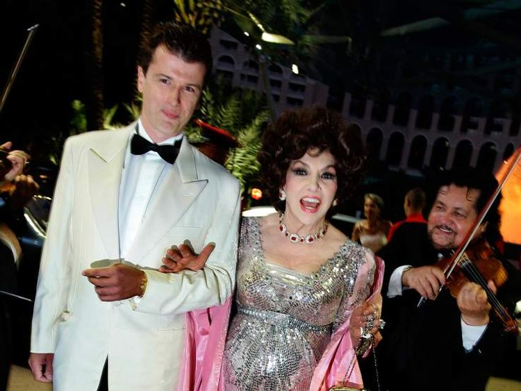 Italian actress Gina Lollobrigida and Javier Rigau Rafols arrive for the opening of the yearly Red Cross ball in Monaco