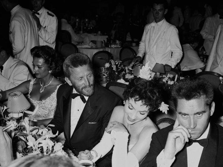 Kirk Douglas, Gina Lollobrigida and her husband Milk Skofic (r) in Monaco in 1955