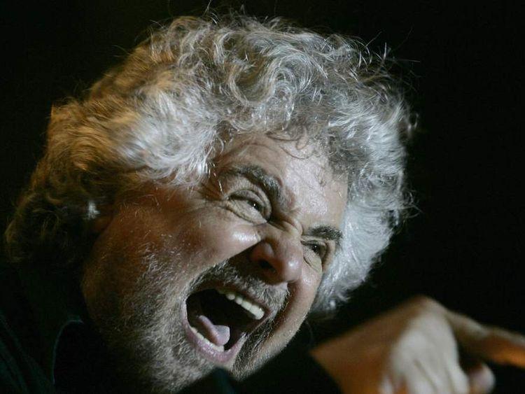 Italian showman Beppe Grillo waves to su
