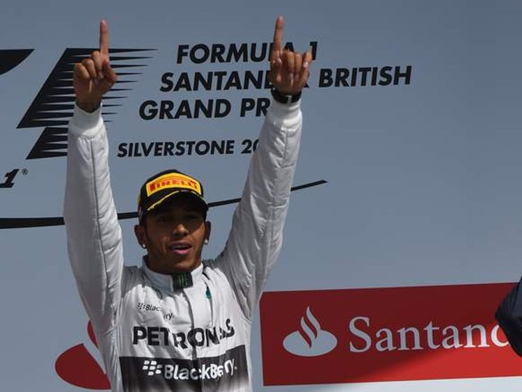 Lewis Hamilton celebrates on the podium after winning the British Grand Prix