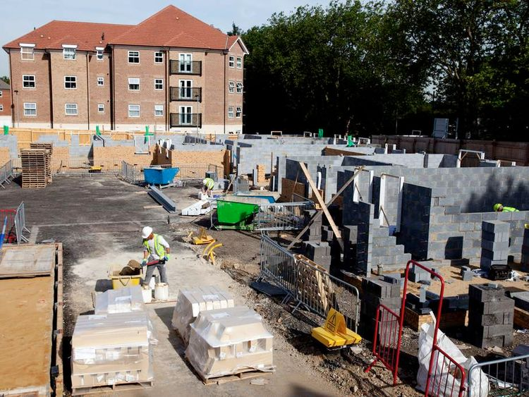 Workers construct residential homes.