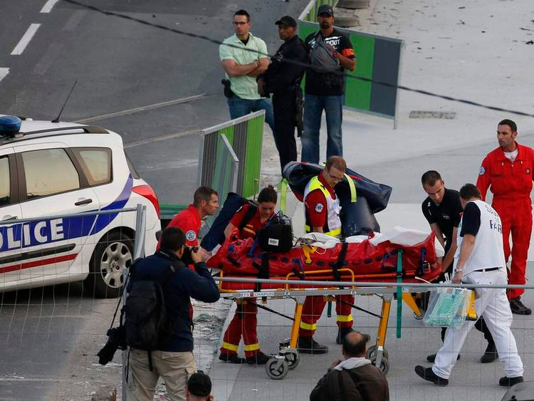 An injured person is carried on a stretcher from the site of an intercity train accident at the Bretigny-sur-Orge station near Paris