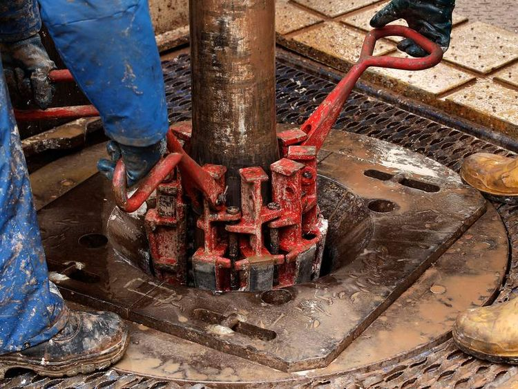 Engineers at work on the drilling platform of a shale fracking facility