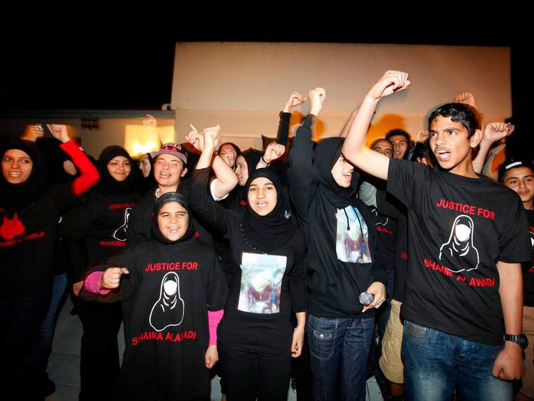 Alhimidi shouts to seek justice during a candlelight vigil to remember Shaima Alawadi outside her home in El Cajon