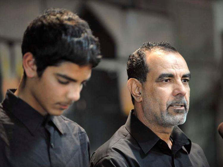 Alhimidi speaks next to son Mohammed during memorial service for Shaima Alawadi in Lakeside, California