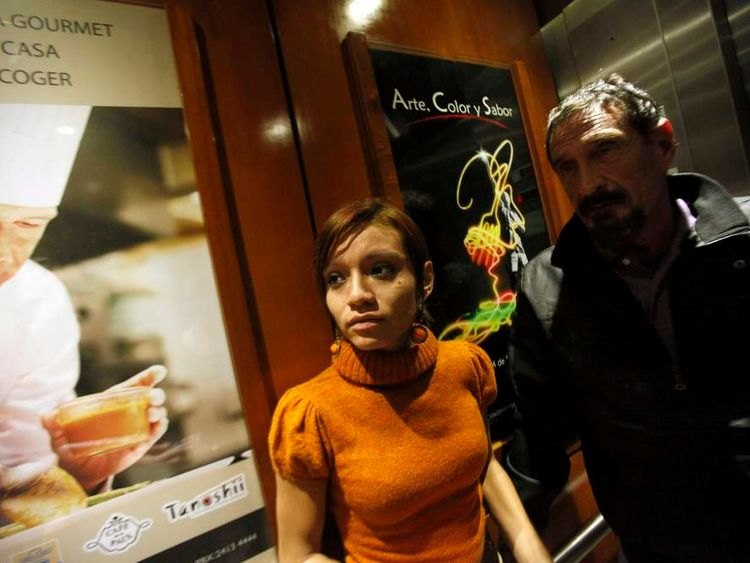 John McAfee, anti-virus software guru is pictured in a hotel elevator with his 20-year-old Belizean girlfriend Sam Vanegas after a interview with Reuters in Guatemala City