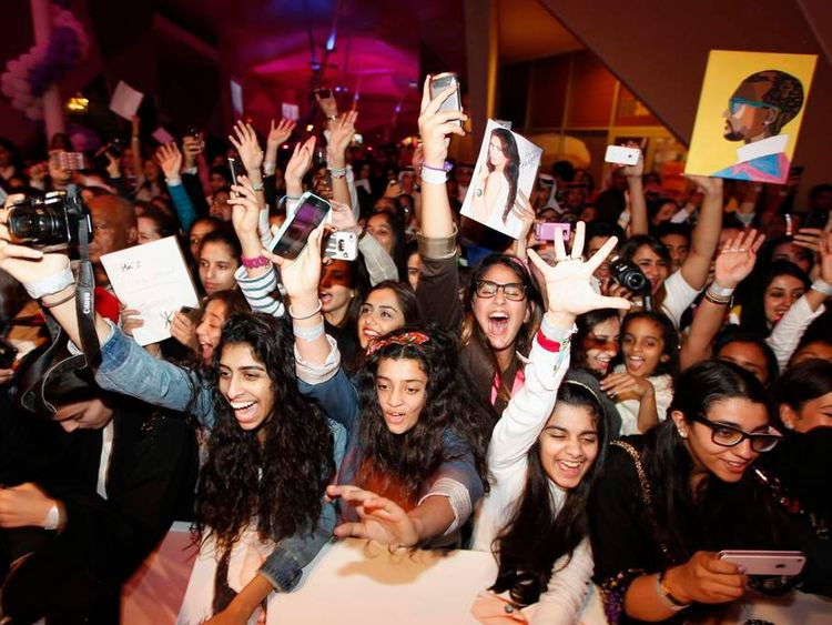 Fans cheer Kim Kardashian during a promotional visit in Riffa, south of Manama
