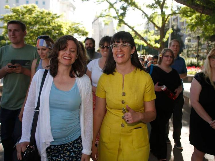 Kelly walks with supporter Bennett during a vigil in Salt Lake City