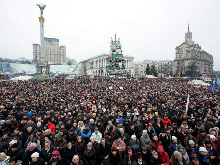 People attend a rally at Independence Square in Kiev