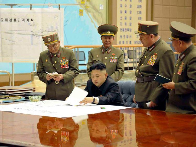 Kim Jong-Un (centre) presides over an urgent operation meeting in Pyongyang