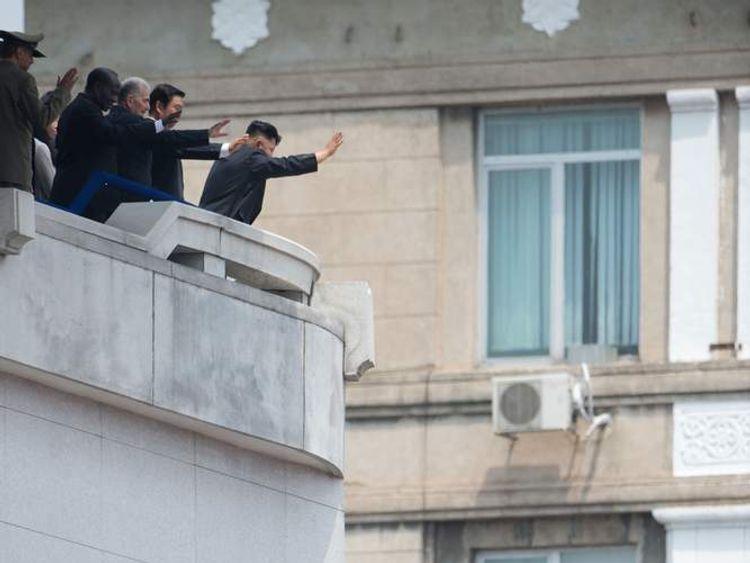 Kim Jong-Un waving from balcony