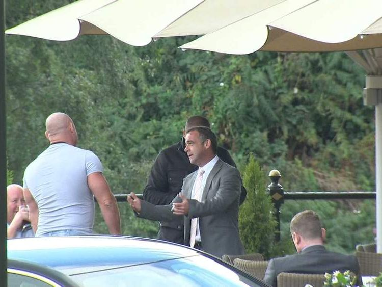 Michael Le Vell outside a pub