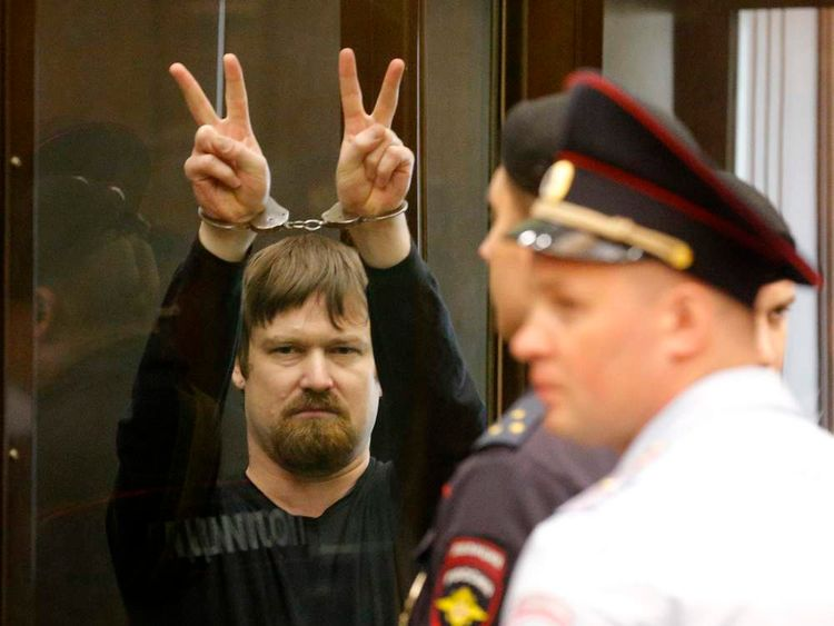LeonidRazvozhayev, co-defendant of opposition leader Udaltsov, gestures from defendants cage during a court hearing in Moscow
