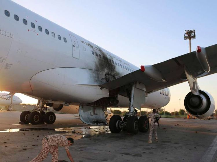 A damaged aircraft is pictured after a shelling at Tripoli International Airport