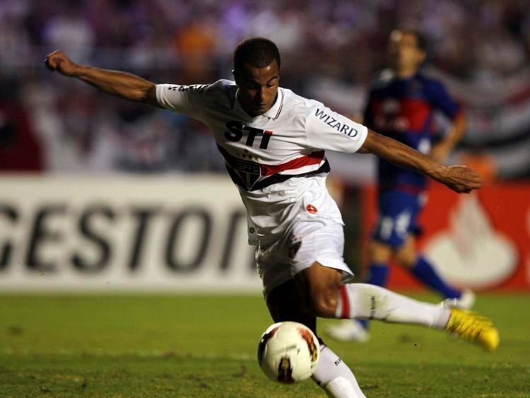 Lucas of Brazil's Sao Paulo scores a goal against Argentina's Tigre