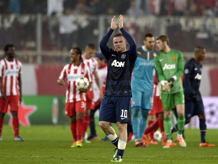 Wayne Rooney sportingly claps at the end of the match