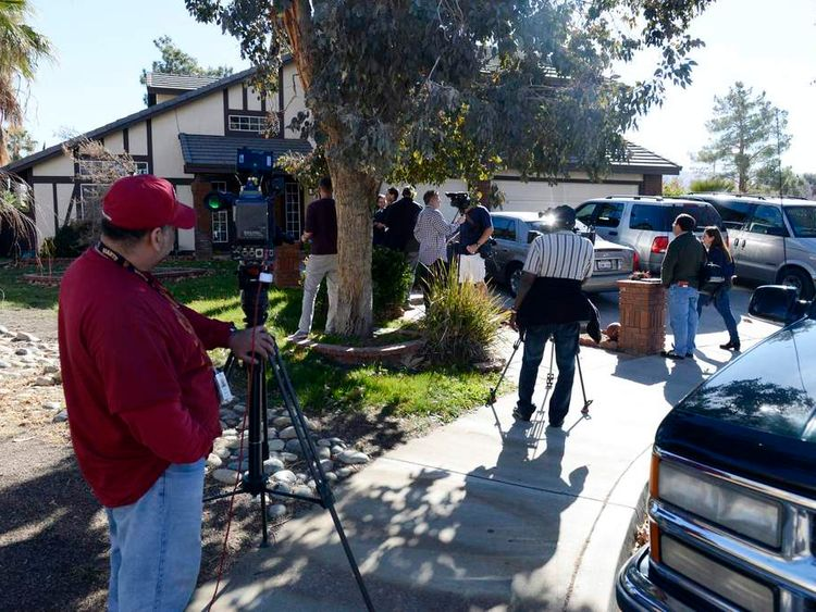 Media gather outside the home of Ronaiah Tuiasosopo in the Los Angeles suburb of Palmdale, California