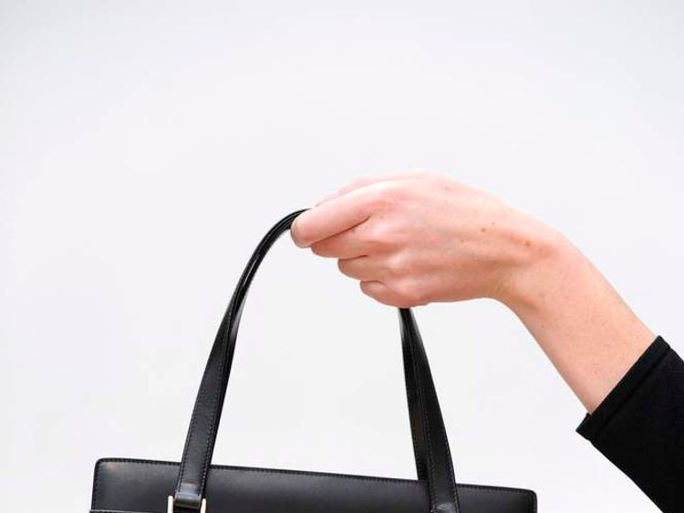 The handbag she wore at Camp David in 1985 was sold at a charity auction