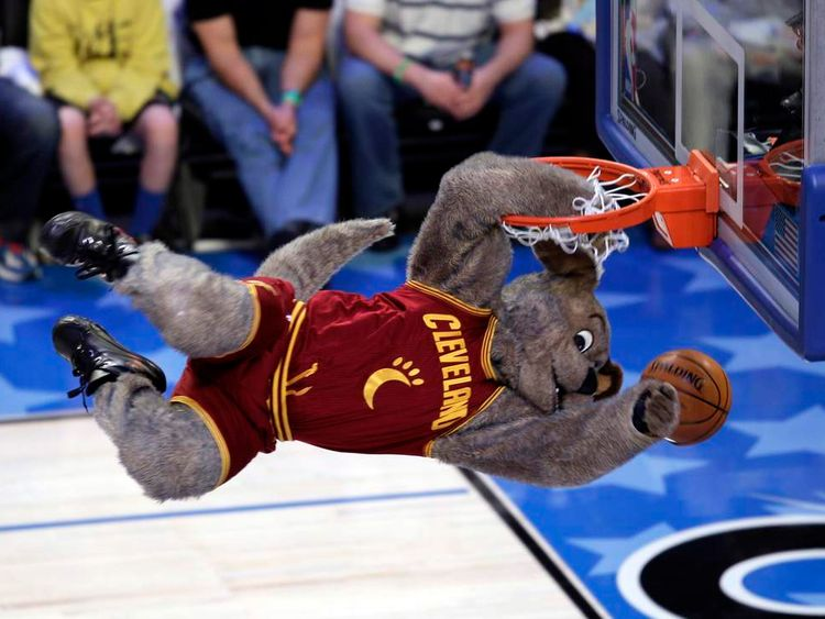 Cleveland Cavaliers' mascot dunks the ball during a break in the BBVA Rising Stars Challenge game in Orlando