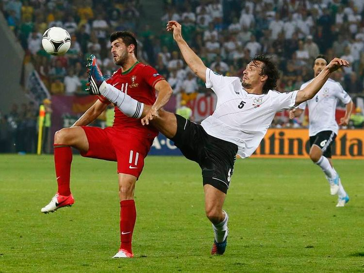 Portugal's Oliveira is challenged by Germany's Hummels during their Group B Euro 2012 soccer match at the New Lviv stadium in Lviv