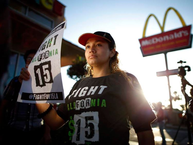 Demonstrators take part in a protest to demand higher wages for fast-food workers outside McDonald's in Los Angeles
