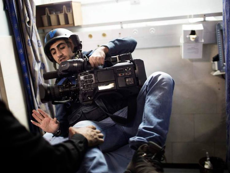 Press TV cameraman arrives in hospital