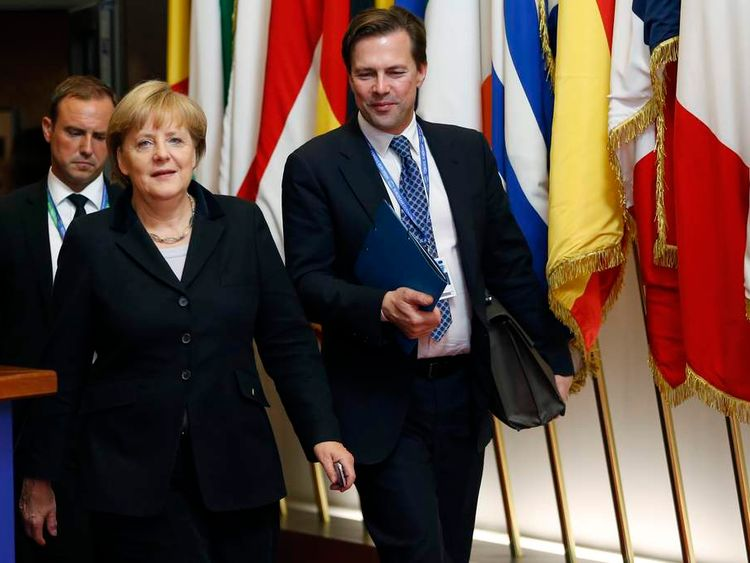Germany's Chancellor Merkel leaves a EU leaders summit at the EU Council in Brussels