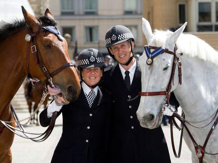 Metropolitan Police horses Laurel (L) and Boris recipients of animal OBEs