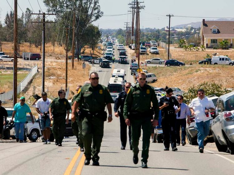 Buses packed with undocumented migrants who were scheduled to be processed at the Murrieta Border Patrol Station retreat up the road after being stopped in their tracks by demonstrators in California