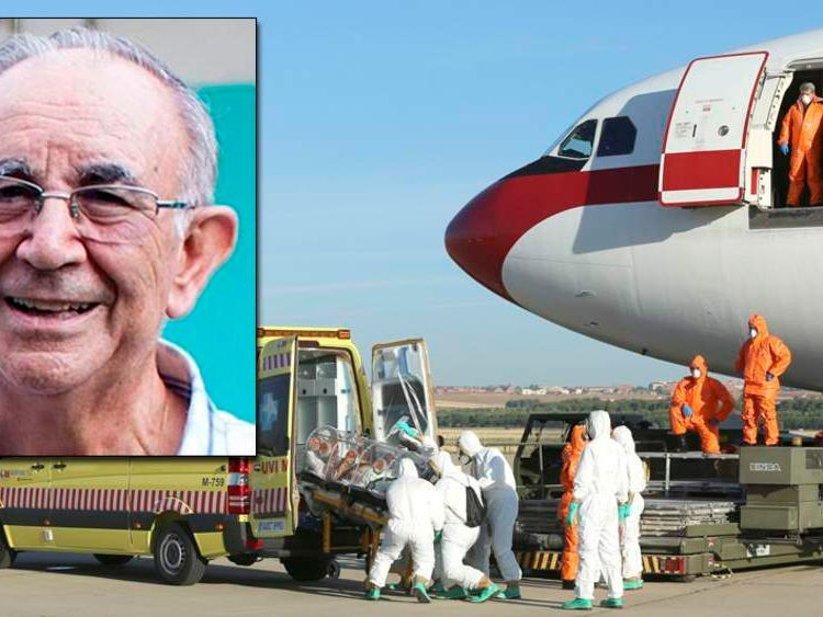 Health workers load Ebola patient, Spanish priest Miguel Pajares, into an ambulance on the tarmac of Torrejon airbase in Madrid