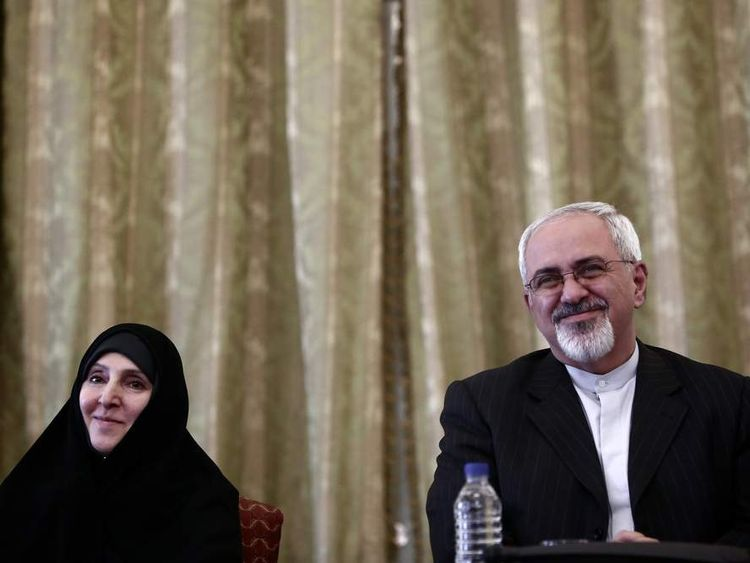 Iranian foreign minister Mohammad Javad Zarif (R) and first-ever female foreign ministry spokesperson Marzieh Afkham