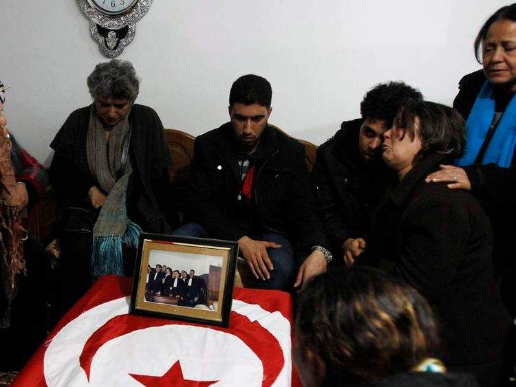 Khalfaoui Belaid, wife of assassinated prominent Tunisian opposition politician Shokri Belaid, joins relatives in mourning next to her husband's coffin, in Jbal Jloud
