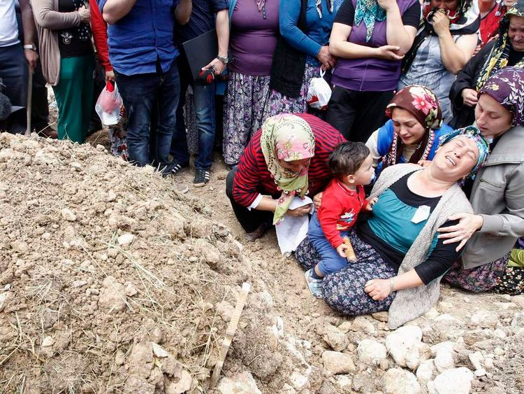 Women mourn during the funeral of a miner in Turkey