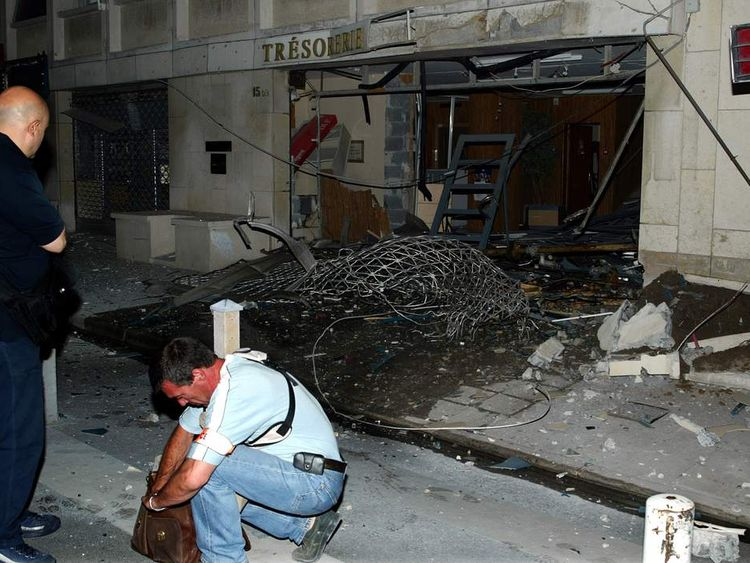 Police investigate the scene at a regional tax office in Nice in 2003
