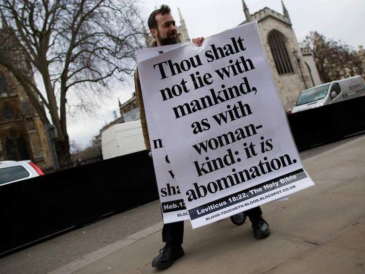 A man campaigns against legislation allowing gat marriage