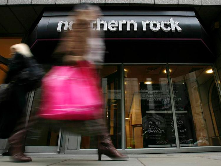 Pedestrians walk past a branch of the Northern Rock bank in the City of London