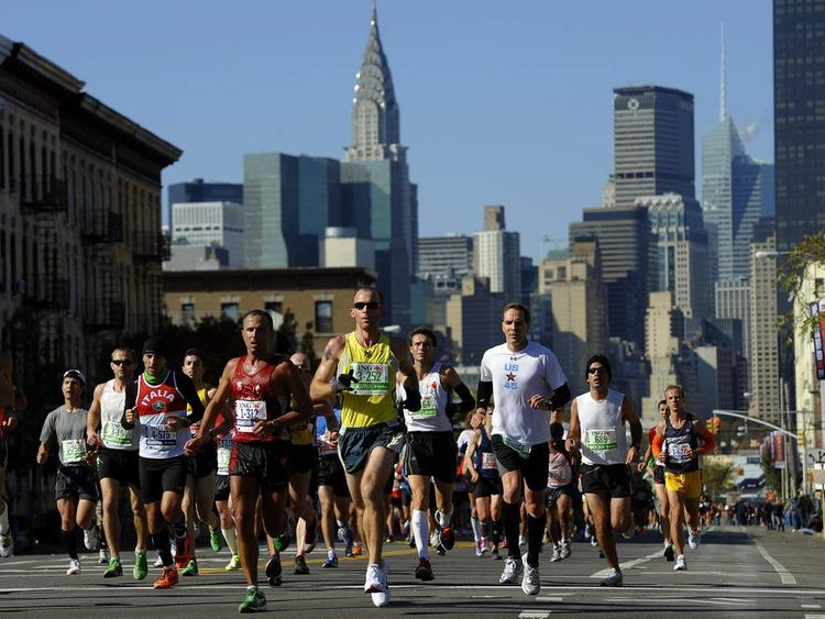 Runners make their way through Queens during the 2011 New York City Marathon.