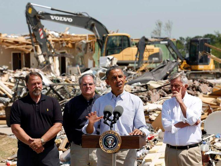 President Barack Obama speaks as he visits the tornado devastated town of Vilonia