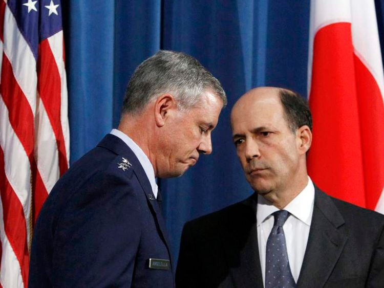 Lt Gen Salvatore Angelella, commander of US Forces Japan, and US Ambassador to Japan John Roos pass each other as they deliver statements in Tokyo