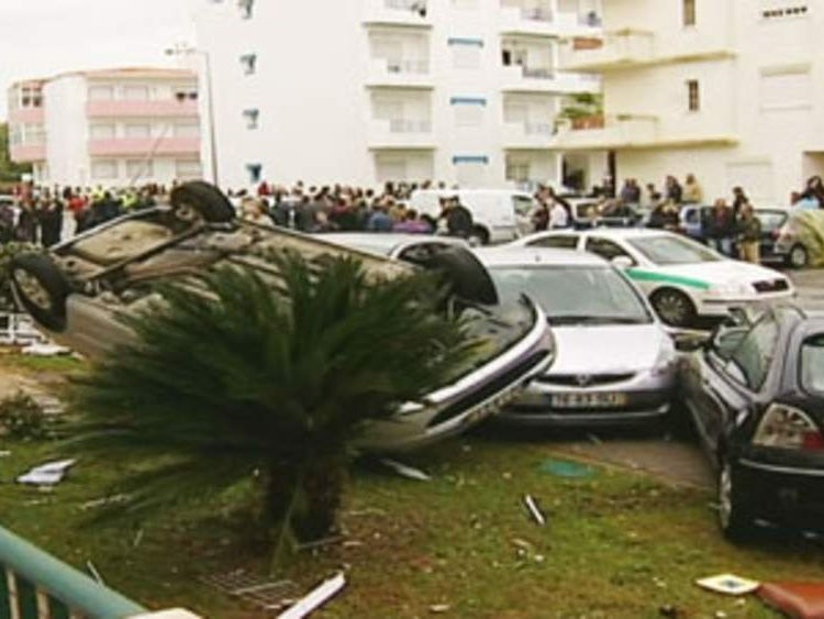 A car is flipped over during a tornado in Portugal.