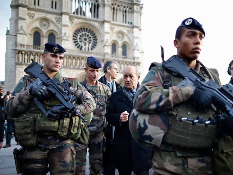 French Minister Jean-Yves Le Drian in front of Notre Dame Cathedral