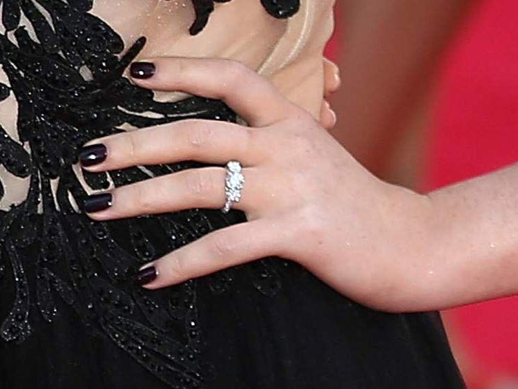 Perrie Edwards wears a ring on her engagement finger