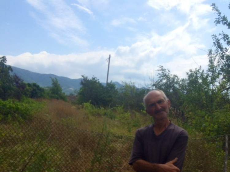 Amiran Gugutishvili, whose orchard has been fenced off