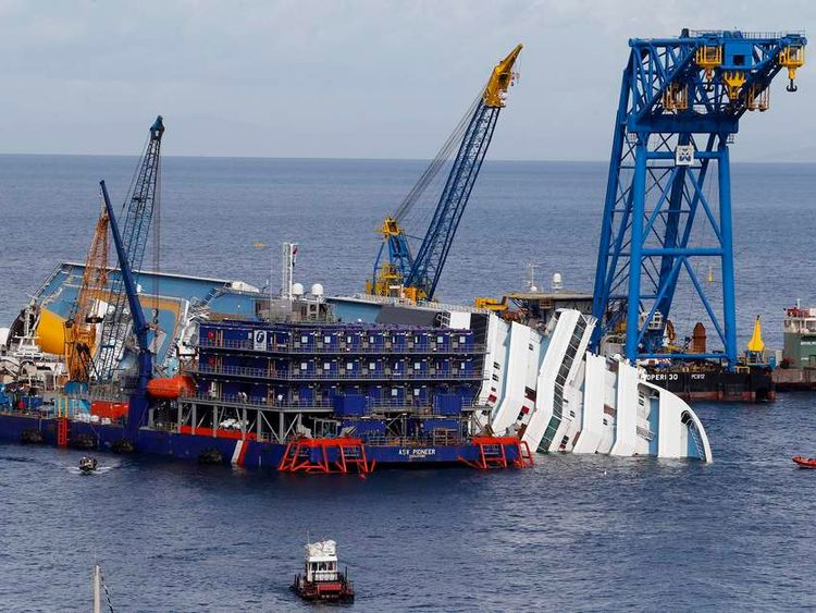 An overview during rescue operation of the capsized cruise liner Costa Concordia surrounded by cranes in front of Giglio harbour