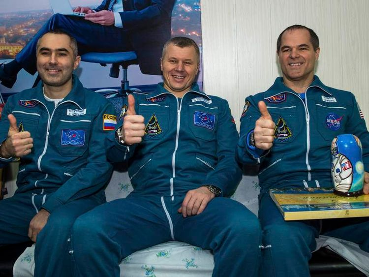 Handout photo of ISS crew members Russian cosmonauts Tarelkin and Novitskiy and U.S. astronaut Ford sit together at Kustanay Airport after they landed near the town of Arkalyk in Kazakhstan
